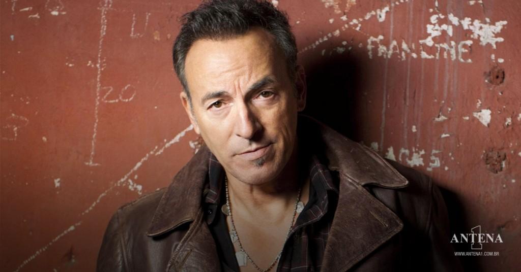 Placeholder - loading - Bruce Springsteen em fundo vermelho