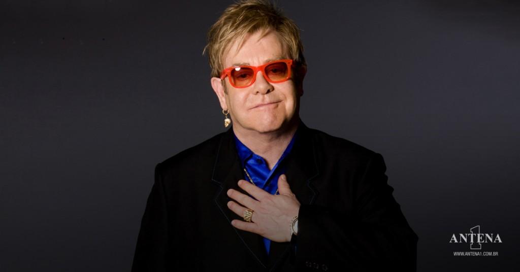 Placeholder - loading - Elton John em fundo preto