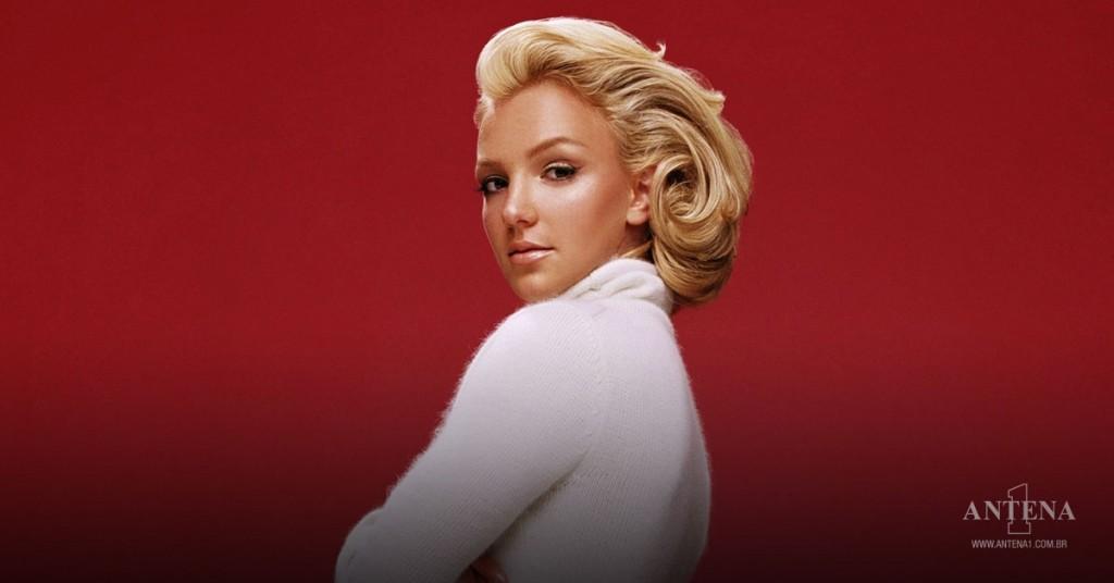 Placeholder - loading - Britney Spears em fundo vermelho