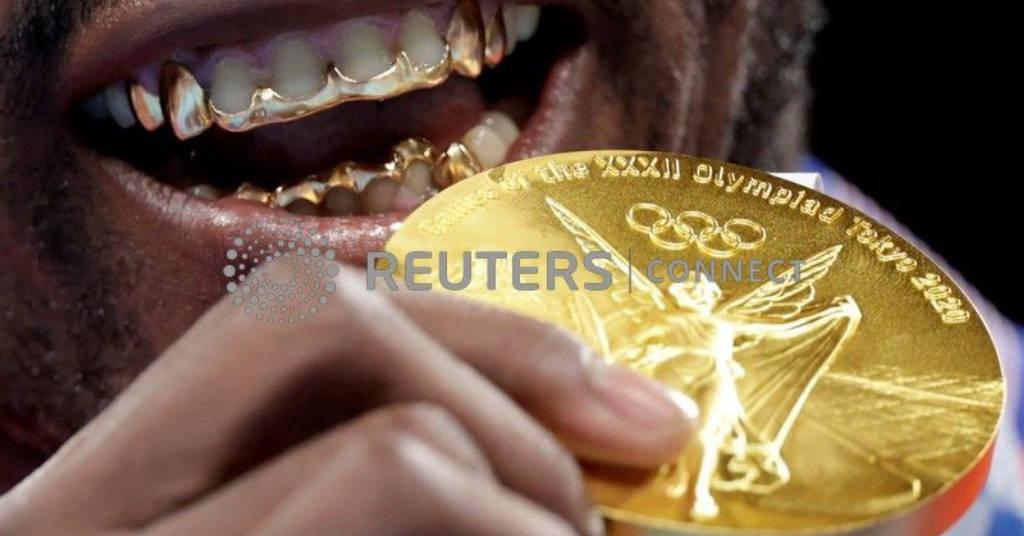 Placeholder - loading - Pugilista cubano Julio Cesar La Cruz comemora a conquista do ouro  REUTERS/Ueslei Marcelino/File photo