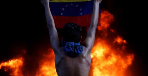 Placeholder - loading - Imagem da notícia Chefe de direitos humanos da ONU pede inquérito sobre mortes na Venezuela