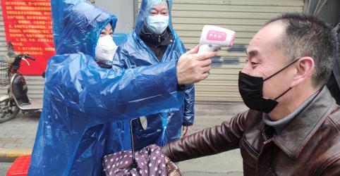 Placeholder - loading - Imagem da notícia CORREÇÃO-China avalia custo econômico do coronavírus em meio a crise de proibições de viagem