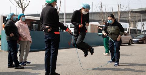 Placeholder - loading - Infecções por coronavírus em cidade chinesa de Wuhan voltam a crescer