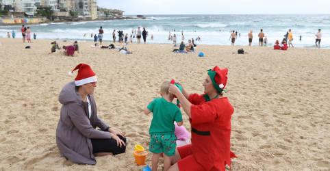Placeholder - loading - Imagem da notícia Chuva e Covid-19 afastam banhistas de praia famosa em Sydney