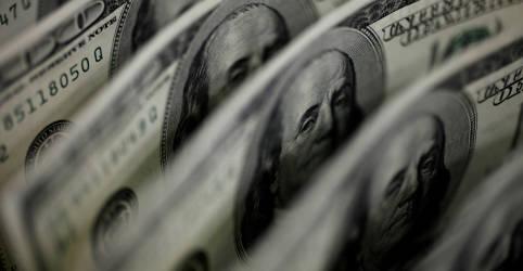 Placeholder - loading - Imagem da notícia Dólar vira e cai seguindo exterior após dados de inflação nos EUA
