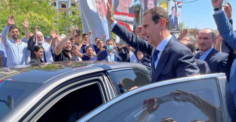 Placeholder - loading - Assad vota em antiga cidade rebelde síria que foi alvo de ataque químico