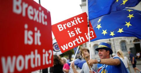 Premiê britânica escapa por pouco de derrota em votação parlamentar sobre leis comerciais