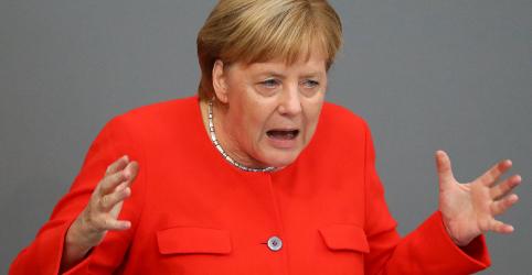 Placeholder - loading - Imagem da notícia Merkel condena xenofobia da extrema-direita alemã e slogansnazistas