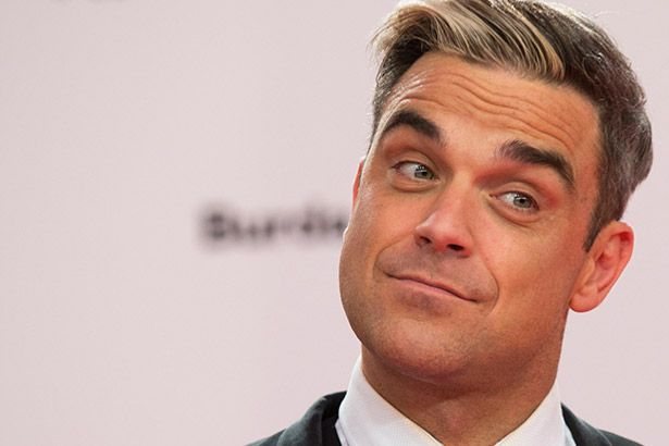 Robbie Williams deseja tocar no Rock in Rio Background