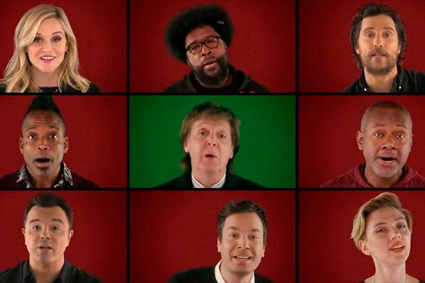 Paul McCartney e outros artistas cantam música de Natal Background